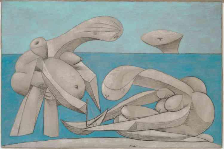 «Deux baigneuses jouent avec un petit bateau à voiles tandis que surgit à l'arrière-plan une tête inquiétante. On a voulu y voir l'image même de l'artiste, transformé en monstre marin, une sorte de Poséidon des temps modernes, épiant les jeux des baigneuses sur la plage.»