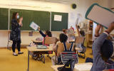 A teacher gives a lesson to the pupils at the Ziegelau elementary school in Strasbourg, eastern France, as primary and middle schools reopen in France on June 22, 2020. - After six weeks of unsteady school sessions and more than three months of class at home to fight against the spread of the new coronavirus Covid-19, French pupils and middle school students return to class on June 22, thanks to a lighter health protocol. (Photo by FREDERICK FLORIN / AFP)