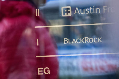 """This picture taken on November 6, 2018 shows the office of US asset manager BlackRock after it was raided by investigators. - German prosecutors on November 6, 2018 raided the Munich offices of the US mammoth asset manager BlackRock as part of a probe into a massive tax scam, Bild newspaper reported. The daily said 15-20 investigators from the Cologne prosecutors' office carried out the search in connection with their inquiry into the firm's role in so-called dividend stripping or """"cum-ex"""" deals between 2007 and 2010. (Photo by Lino Mirgeler / dpa / AFP) / Germany OUT"""