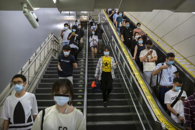 Dans le métro de Pékin, le 9 juillet.