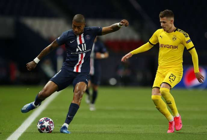 Presnel Kimpembe face à Thomas Hazard, lors de PSG-Dortmund (16es de finale de la Ligue des champions), le 11 mars 2020, au Parc des Princes.