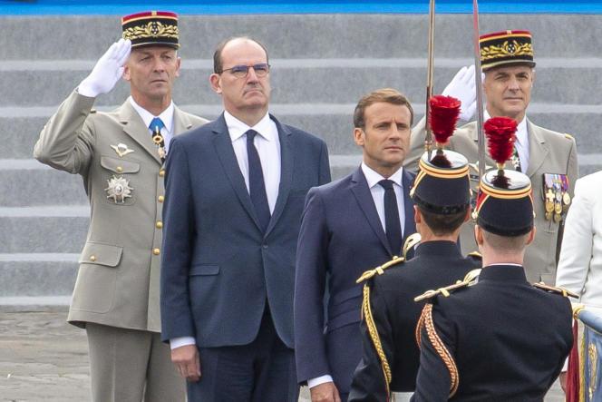 Jean Castex et Emmanuel Macron, à la cérémonie militaire de la Fête nationale sur la place de la Concorde, à Paris, le 14 juillet.