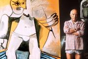 Pablo Picasso pose, en 1971, à côté d'une de ses dernières toiles.