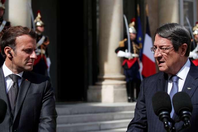 Le président français, Emmanuel Macron, et son homologue chypriote, Nicos Anastasiades, àl'Elysée, à Paris, le 23juillet.