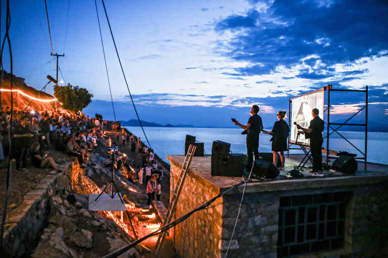 """Performance during the opening of David Shrigley's """"Laughterhouse"""" at the DESTE Foundation Project Space on Hydra island in 2018"""