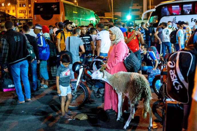 Moroccans gathered at a Casablanca bus station on July 26, 2020, to leave the city before authorities impose travel restrictions.