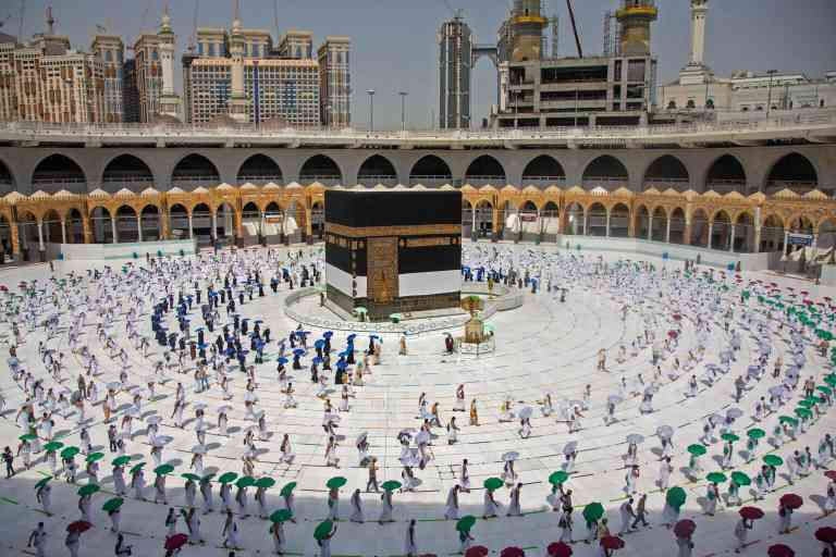 A hadnout picture released by the Saudi ministry of media shows pilgrims circumambulating around the Kaaba, Islam's holiest shrine, at the centre of the Grand Mosque in the holy city of Mecca at the start of the annual Muslim Hajj pilgrimage on July 29, 2020.  Mask-clad Muslim pilgrims began the annual hajj, dramatically downsized this year as the Saudi hosts strive to prevent a coronavirus outbreak during the five-day pilgrimage. The hajj, one of the five pillars of Islam and a must for able-bodied Muslims at least once in their lifetime, is usually one of the world's largest religious gatherings. - RESTRICTED TO EDITORIAL USE - MANDATORY CREDIT
