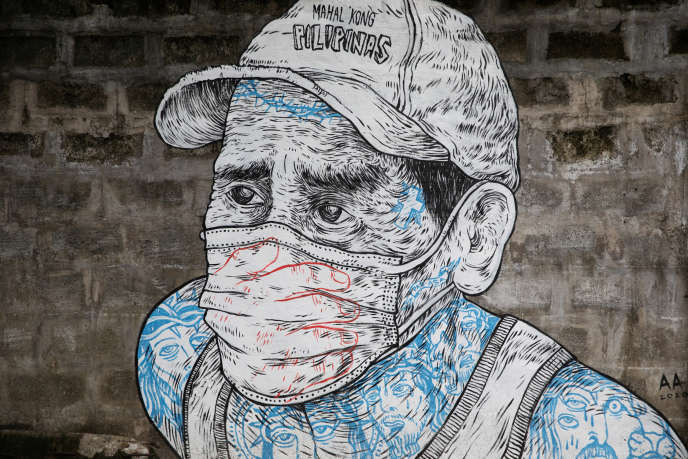 Mural of a man wearing a mask on a sidewalk in Quezon City, Philippines, July 30.