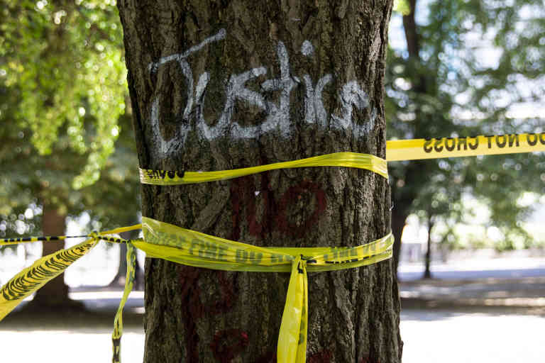 Police tape surrounds Chapman Square in downtown Portland, Oregon, U.S., on July 30, 2020.