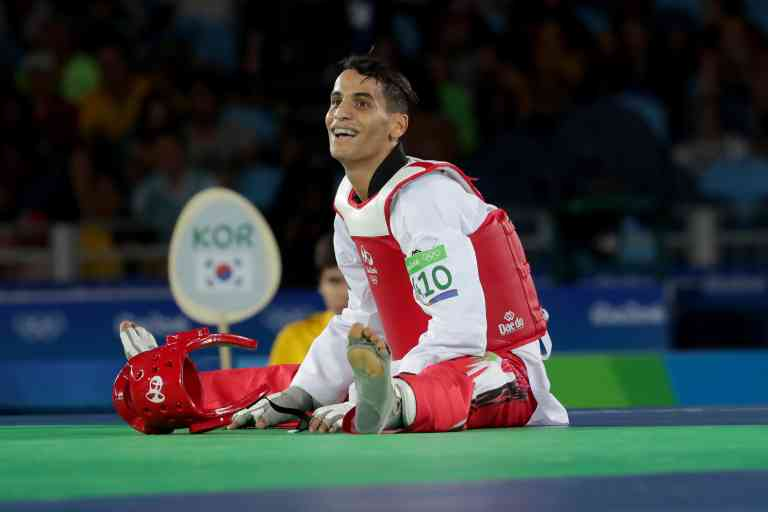 Aug 18, 2016; Rio de Janeiro, Brazil; Ahmad Abughaush (JOR) celebrates his victory over Daehoon Lee (KOR) in a men's taekwondo 68kg match at Carioca Arena 3 during the Rio 2016 Summer Olympic Games. Mandatory Credit: Dan Powers-USA TODAY Sports