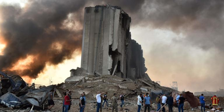 EDITORS NOTE: Graphic content / TOPSHOT - A picture shows a destroyed silo at the scene of an explosion at the port in the Lebanese capital Beirut on August 4, 2020. Two huge explosion rocked the Lebanese capital Beirut, wounding dozens of people, shaking buildings and sending huge plumes of smoke billowing into the sky. Lebanese media carried images of people trapped under rubble, some bloodied, after the massive explosions, the cause of which was not immediately known.  / AFP / STR