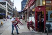 Dans une rue marchande du centre de Londres, le 12 août.