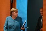 La chancelière allemande, Angela Merkel, face au vice-chancelier et ministre des finances, Olaf Scholz, à Berlin, le 12 août.