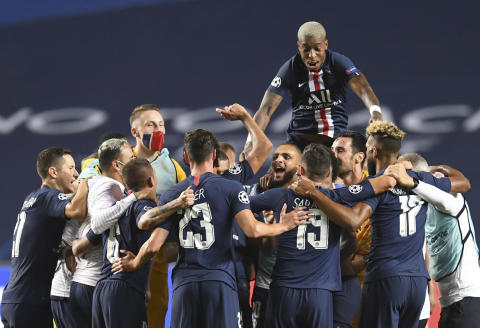 PSG players celebrate at the end of the Champions League semifinal soccer match between RB Leipzig and Paris Saint-Germain at the Luz stadium in Lisbon, Portugal, Tuesday, Aug. 18, 2020. (David Ramos/Pool Photo via AP)