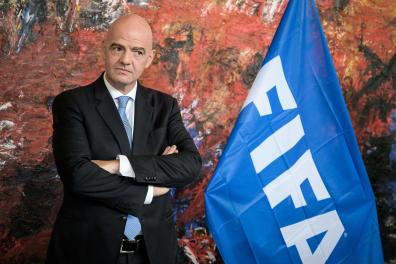 (FILES) This file photo taken on October 4, 2019 shows FIFA president Gianni Infantino looking on during the sign memorandum of understanding with World Health Organization (WHO) aimed at promoting and protecting public health globally through football in Geneva. FIFA's ethics committee on August 19, 2020, decided to close a case against president Gianni Infantino over possible ethics violations following a preliminary investigation by its investigatory chamber. / AFP / FABRICE COFFRINI
