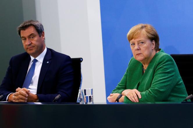 Markus Söder,ministre-président de Bavière, et Angela Merkel lors d'une conférence de presse, le 27 août.