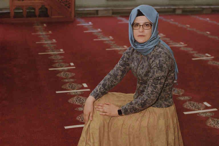 Hatice Cengiz sitting on the Jamal Khashoggi's prayer rug, in Çukurcuma mosque.