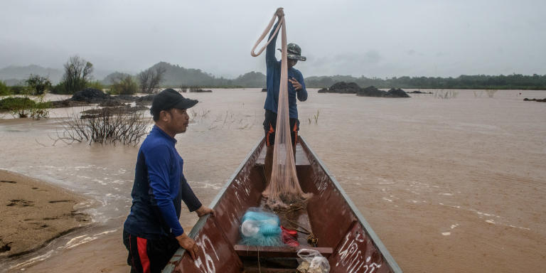 Fishers are out fishing, surrounded by small islands popping out of the water, as a result of the low water levels on the Mekong River, caused by dams upstream. This severely reduces their chances of catching fish. Sangkhom district, Nong Khai, Thailand – August 2020.