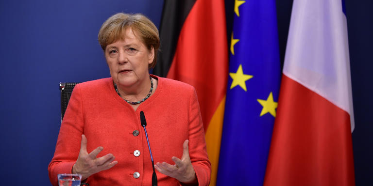 German Chancellor Angela Merkel speaks during a joint video press conference with French President Emmanuel Macron (off screen) at the end of the European summit at the EU headquarters in Brussels on July 21, 2020. - EU leaders approved a 750-billion-euro package to revive their coronavirus-ravaged economies after a tough 90-hour summit on July 21, along with a trillion-euro budget for the next seven years. (Photo by JOHN THYS / POOL / AFP)