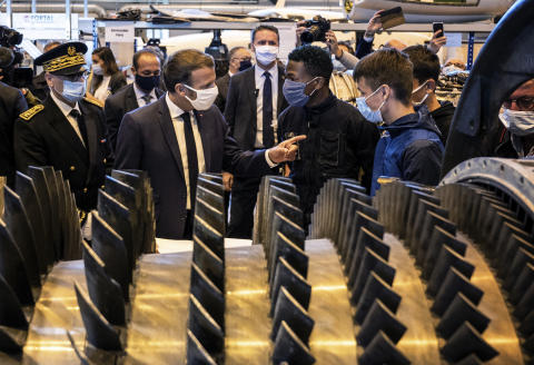 French President Emmanuel Macron, second left, talks with students, Tuesday Sept. 8, 2020, as he visits the Aeronautical campus of Roger Claustres high school in Aulnat airport, central France. (Jeff Pachoud, Pool via AP)