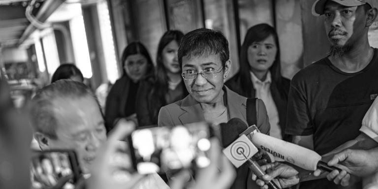 Maria Ressa, the editor and founder of Philippine publication Rappler, is seen speaking to media after her hearing in the Manila City hall in Manila, Philippines. Since President Rodrigo Duterte took office in the Philippines, Rappler has investigated Duterte's extrajudicial killing campaign against drug dealers, and has documented the spread of government disinformation on Facebook. The Duterte administration has filed several cases against Ressa, who has posted bail 8 times, and has been arrested twice. Pictures taken in June and July 2019 for the NY Times