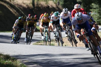 The pack rides during the 14th stage of the 107th edition of the Tour de France cycling race, 197 km between Clermont-Ferrand and Lyon, on September 12, 2020. / AFP / KENZO TRIBOUILLARD