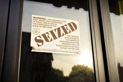 NEW YORK, NEW YORK - AUGUST 21: A sticker placed on the door of a restaurant declares the establishment was seized due to non-payment of taxes in the Brooklyn borough of New York City on August 21, 2020. Many food establishments have suffered a 40-50% decline in revenue since the Covid-19 pandemic with many owners declaring bankruptcy or closing completely. (Photo by Robert Nickelsberg/Getty Images)