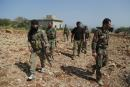 """AFRIN, SYRIA - APRIL 02: Turkish soldiers and Free Syrian Army (FSA) members conduct search works in Afrin's northwestern Raju town, which was liberated from YPG/PKK-Daesh terrorists, within the """"Operation Olive Branch'' in Syria on April 02, 2018. Omer Alven / Anadolu Agency"""