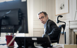 This photograph taken on 13 July, 2020, shows French Ecologist party Europe Ecologie Les Verts' (EELV) Pierre Hurmic during an interview in his office at the city hall of Bordeaux, south-western France. (Photo by Philippe LOPEZ / AFP)