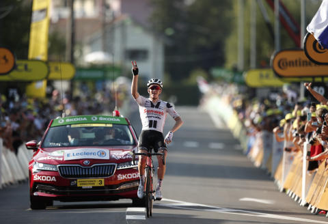 Denmark's Soren Kragh Andersen celebrates as he crosses the line to win the 19th stage of the Tour de France cycling race over 166.5 kilometers between Bourg-En-Bresse and Champagole, France Friday, Sept. 3, 2020. (Marco Bertorello/Pool via AP)