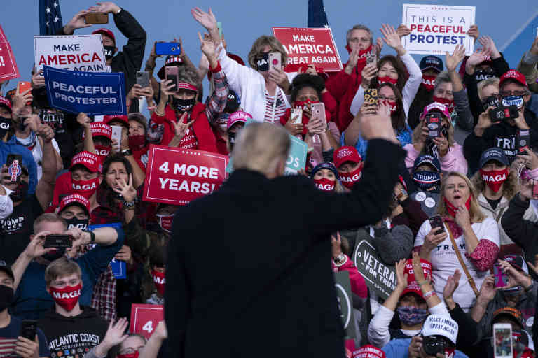 Supporters of President Donald Trump cheer as he arrives to speak during a campaign rally at Fayetteville Regional Airport, Saturday, Sept. 19, 2020, in Fayetteville, N.C. (AP Photo/Evan Vucci)