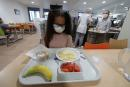 A secondary school student, wearing a protective face mask, sits in front of her meal tray in the school canteen room at the College Henri Matisse school during its reopening in Nice as French children return to their schools after the summer break with protective face masks and social distancing as part of efforts to curb a resurgence of the coronavirus disease (COVID-19) across France, September 1, 2020. REUTERS/Eric Gaillard