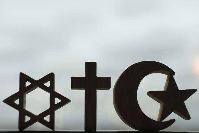 Symboles du judaïsme, du christianisme et de l'islam.
