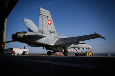 A F / A-18 Hornet fighter jet of the Swiss Air Force is pulled out of a shed on February 19, 2019 at Payerne Air Base. (Photo by Fabrice COFFRINI / AFP)