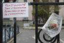 """A picture taken on October 5, 2019 in Pantin, north-east of Paris, shows flowers displayed and a message reading """"More humanity in the institution, let's find the meaning of education again"""" on the Mehul nursery school gate during a march in tribute to Christine Renon, the nursery school director who committed suicide after denouncing the deterioration of working condition. (Photo by GEOFFROY VAN DER HASSELT / AFP)"""