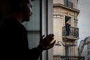 French disc-jockey DJ Knightood plays a set for his neighbours from his apartment window, after the usual 8 p.m. applause in honour of the healthcare workers on the frontlines of the COVID-19 epidemic, in Paris on April 3, 2020 during the strict lockdown in France to stop the spread of the novel coronavirus. (Photo by Philippe LOPEZ / AFP)