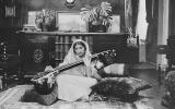 """This handout picture received from Shrabani Basu at the Noor Inayat Khan Memorial trust on November 8, 2012 shows late former British secret agent Noor Inayat Khan playing a Veena. A statue of Noor Inayat Khan was unveiled in Gordon Square Gardens, central London on November 8, 2012 in London, England by Princess Anne. Noor Inayat Khan worked as a radio operator for the Women's Auxiliary Air Force before being recruited by the Special Operations Executive as an agent, working behind enemy lines in Paris, France. She was eventually captured, tortured and beaten before being executed at Dachau Concentration Camp, aged 30. """" RESTRICTED TO EDITORIAL USE - MANDATORY CREDIT """" AFP PHOTO / Noor Inayat Khan Memorial trust/Shrabani Basu """" - NO MARKETING NO ADVERTISING CAMPAIGNS - DISTRIBUTED AS A SERVICE TO CLIENTS """" (Photo by HO / Noor Inayat Khan Memorial trust / AFP)"""