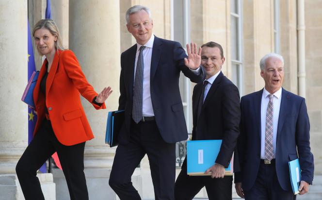 Agnès Pannier-Runacher, Bruno Le Maire, Olivier Dussopt et Alain Griset, dans la cour de l'Elysée, le 7 juillet.