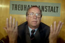 Portrait of top manager Detlev Rohwedder as he gestures with his hands during a press conference, March 27, 1991 in eastern Berlin, Germany. This is one of the last photos taken of Rohwedder. Rohwedder was assacinated five days later as he was sitting on a chair at his desk in his home in Dusseldorf, Germany, Monday evening April 1, 1991 when he was shot by a sniper. April 2, 1991 a letter was sent by the RAF (Rote Armee Fraction - Red Army Faction) to the Associated Press office in Dusseldorf claiming responsibility. (AP Photo/Jockel Finck)