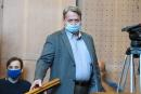 """Hungarian former member of the European Parliament Bela Kovacs arrives in the courtroom for a hearing in his trial for spying on the EU for Russia and for fraud against EU institutions on September 24, 2020 at Budapest Regional Court. The charges, filed in 2017 against Bela Kovacs, 60, comprised """"spying against EU institutions"""" and """"engaging in espionage in the interests of a foreign state"""" between 2012 and 2014. Kovacs was acquitted but was found guilty however, along with three former interns, of fiscal fraud and falsification of documents by signing """"fictitious"""" internship contracts leading to substantial financial losses to EP institutions. / AFP / ATTILA KISBENEDEK"""