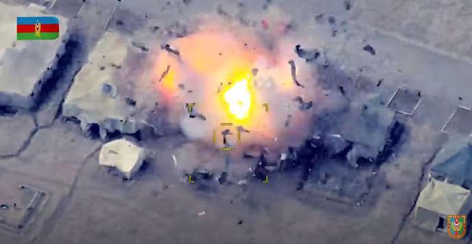 Image extraite d'une vidéo montrée sur le site Internet officiel du ministère de la défense de l'Azerbaïdjan datant du 2 octobre montrant, selon les explications données sur le site, des unités azéries détruisant un poste de contrôle arménien au Haut-Karabakh.