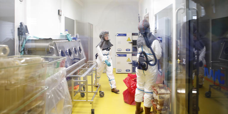 Lab technicians have to wear protective suits and carry a respirator when working with SARS-CoV2