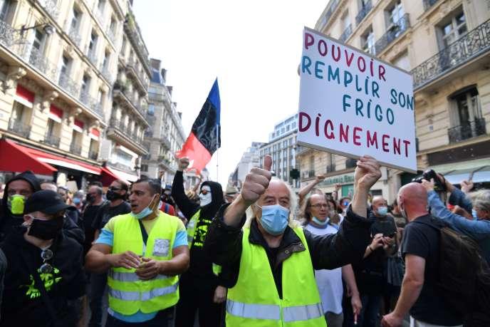Lors d'une manifestation, à Paris, le 12 septembre.