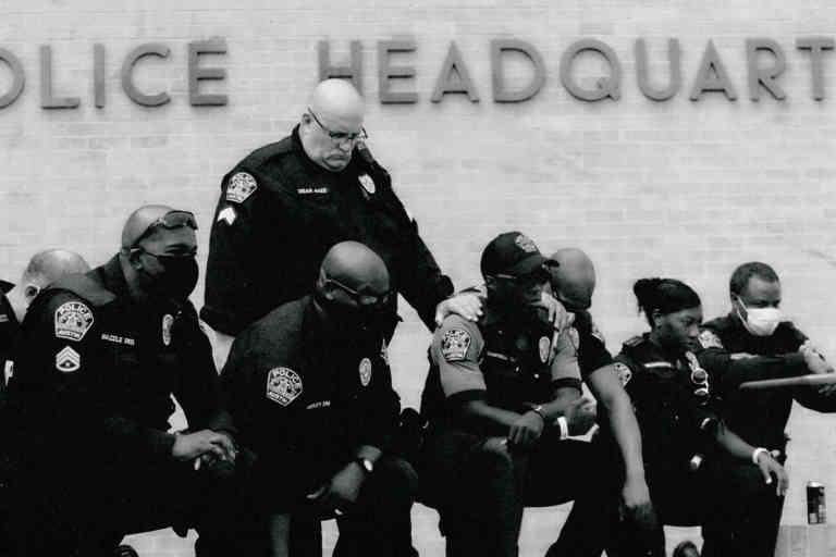 Members of the Austin Police Department kneel in front of demonstrators who gathered in Austin, Texas, Saturday, June 6, 2020, to protest the death of George Floyd, a black man who was in police custody in Minneapolis. Floyd died after being restrained by Minneapolis police officers on Memorial Day. (AP Photo/Eric Gay)/TXEG105/20158705462753//2006062140