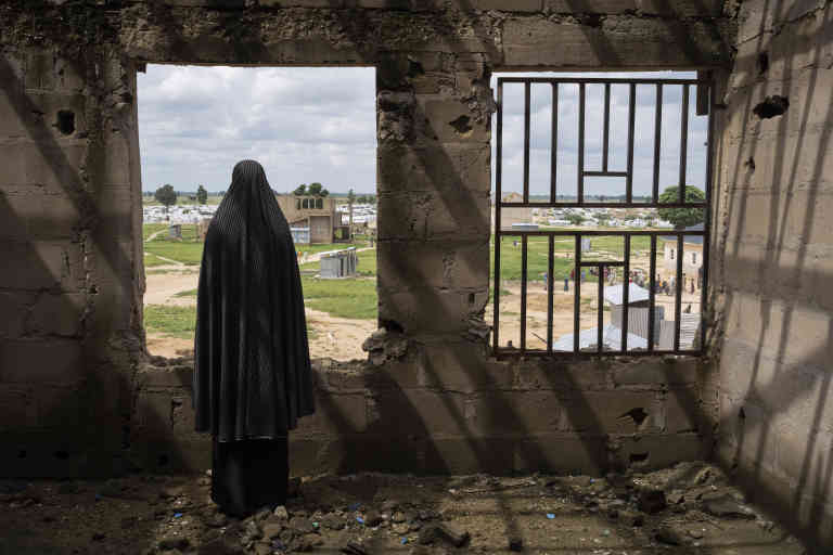 A woman who was kidnapped by Boko Haram and recruited as a bomber at an abandoned building at a camp for displaced people in Konduga, Nigeria, Aug. 20, 2019. Hundreds of women in Nigeria have been recruited by Boko Haram as suicide bombers, but some managed to outsmart the terrorist group. (Laura Boushnak/The New York Times) *** Local Caption *** AFRICA NIGERIA BOMB BOKO HARAM TERRORISM SURVIVOR