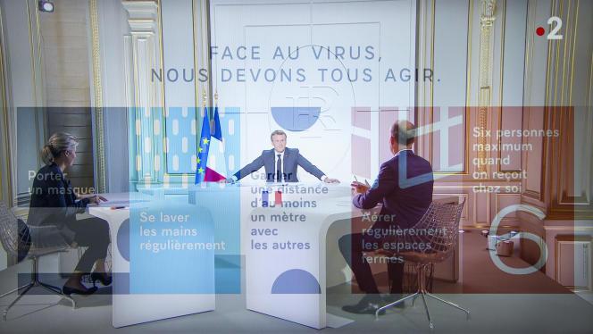 Emmanuel Macron, président de la République, est interviewé sur TF1 et France 2 par Anne-Sophie Lapix et Gilles Bouleau à propos de l'épidémie de Covid-19, le 14 octobre.