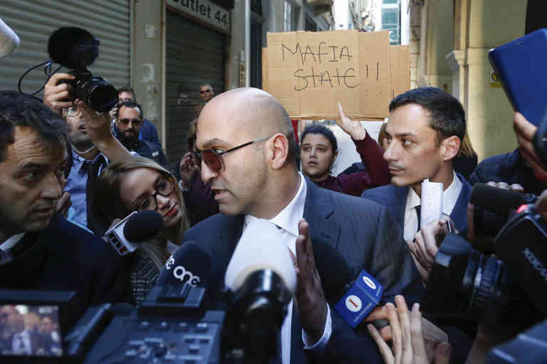 Maltese businessman Yorgen Fenech, who was taken into custody by police last week as he was trying to flee the island, receives media attention as he leaves court after being questioned in the 2017 bomb blast that killed investigative journalist Daphne Caruana Galizia as she drove near her home, in Valletta, Malta, Friday, Nov. 29. 2019. (AP Photo/str)