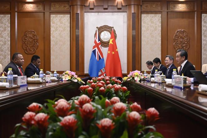 Lors d'une rencontre entre officiels chinois et fidjiens, à Pékin, en 2019.
