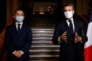French President Emmanuel Macron wearing a face mask delivers a speech next to French Interior Minister Gerald Darmanin at the end of a visit about the fight against separatism at the Seine-Saint-Denis prefecture headquarters in Bobigny, near Paris, France October 20, 2020. Ludovic Marin/Pool via REUTERS