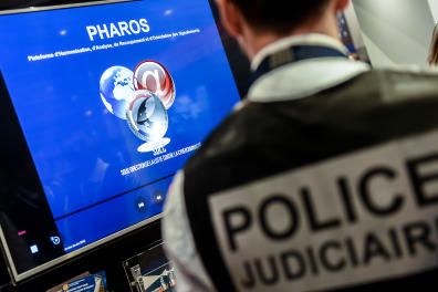 A photo shows a view of the PHAROS platform (Plateforme d'Harmonisation, d'Analyse, de Recoupement et d'Orientation des Signalements), which allows for the reporting of illegal content and behavior on the internet, during the 10th International Cybersecurity Forum in Lille on January 23, 2018. (Photo by PHILIPPE HUGUEN / AFP)
